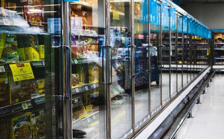Aisle of fridges in grocery store